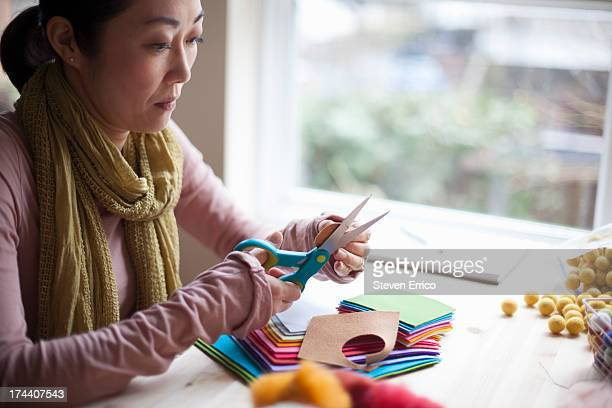 Woman cutting felt in studio