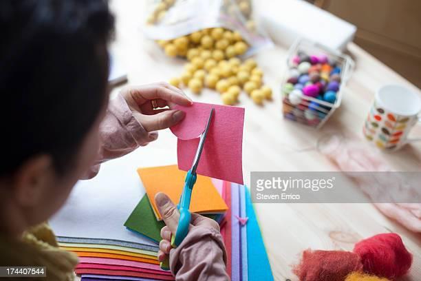 Woman cutting felt in studio