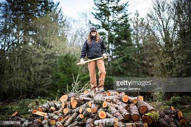 A woman cutting fire wood.