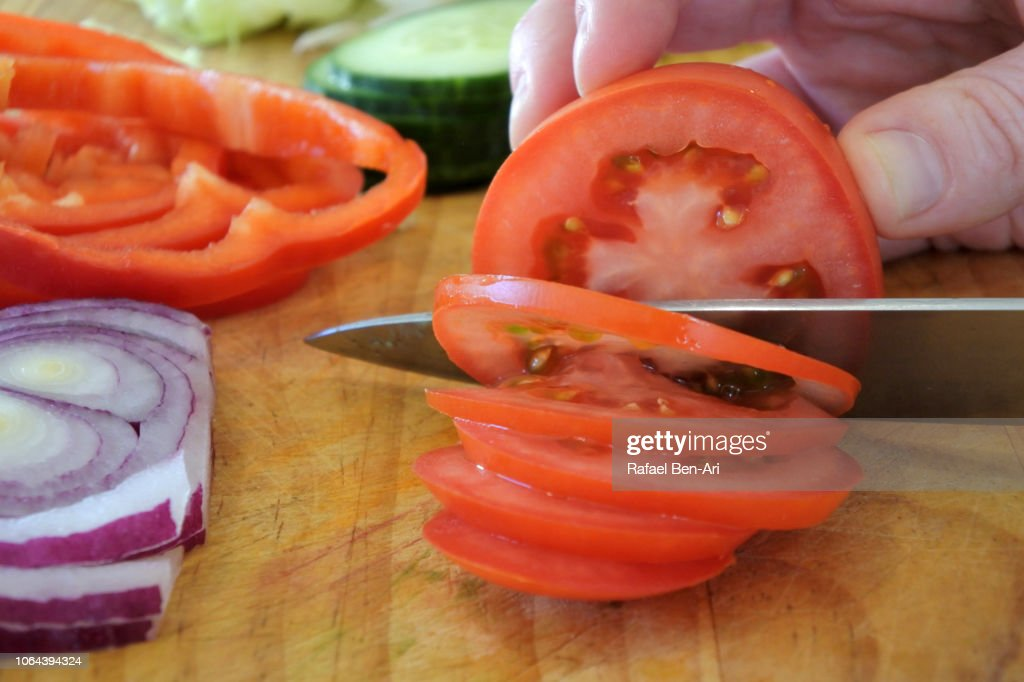 Woman Cutting Fresh Green Salad Ingredients on a Wooden Cutting Board : Stock Photo