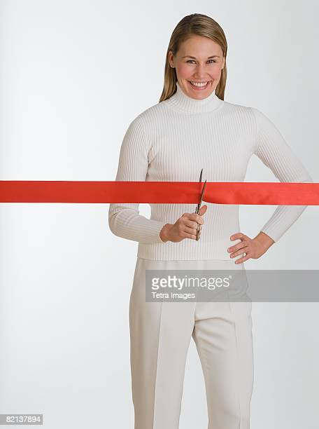 woman cutting red tape - opening event stock pictures, royalty-free photos & images