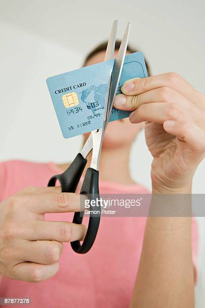 Woman cutting up her credit card