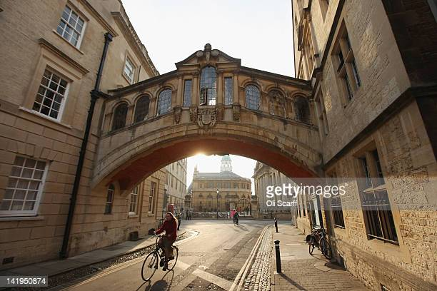 A woman cycles under the Bridge of Sighs along New College Lane on March 22 2012 in Oxford England With only a few months to go until the opening...