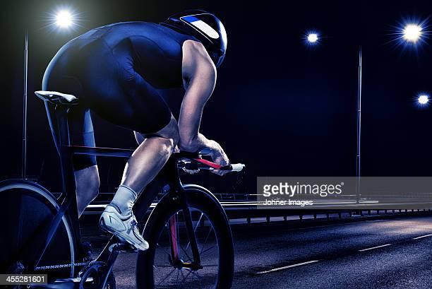 Woman cycling at night