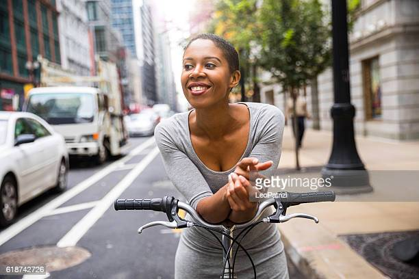 Woman cycling - commuter in downtown Chicago
