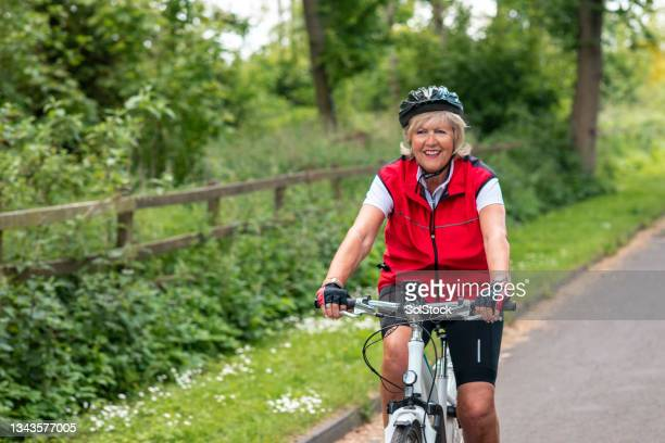 woman cycling in the countryside - morpeth stock pictures, royalty-free photos & images