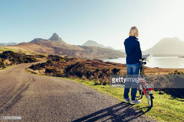 woman cycling in wester ross, scotland - cycling stock pictures, royalty-free photos & images