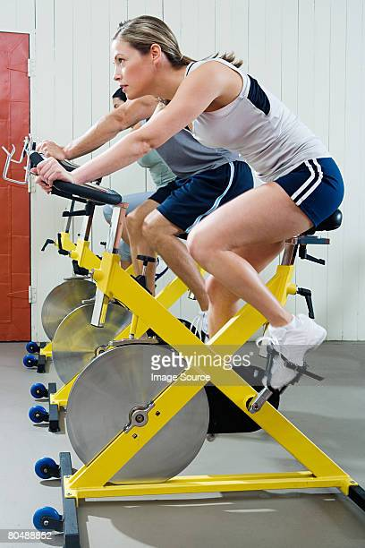 A woman cycling on an exercise bike