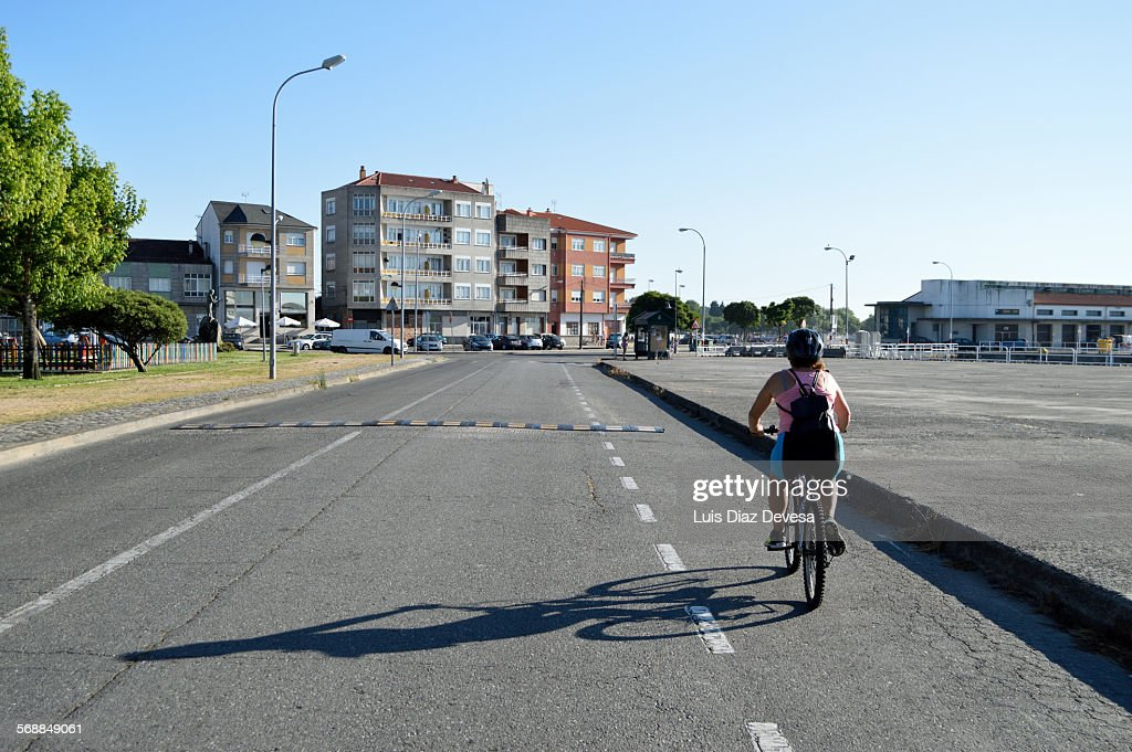 Woman cycling on her bike : Bildbanksbilder