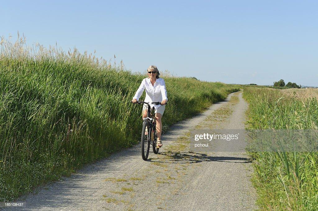 Woman cycling : Stock Photo