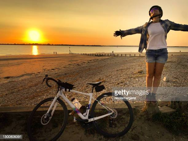 woman cyclist enjoying freedom - portsmouth england stock pictures, royalty-free photos & images