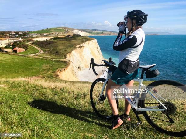 woman cyclist photographer, isle of wight - freshwater bay isle of wight stock pictures, royalty-free photos & images