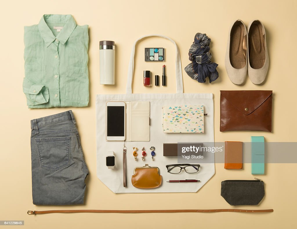 Woman daily supplies shot knolling style. : Stock Photo