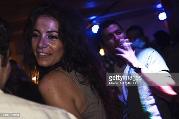 A woman dance disco music during Egyptian upper class party at the Terrace of Nile City Towers on July 20 2011 in Cairo Egypt