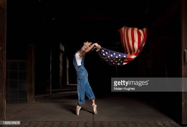 woman dancer holding up American Flag