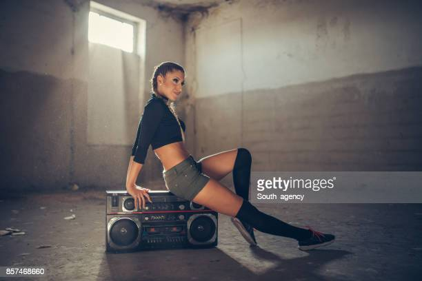 Woman dancer sitting on radio