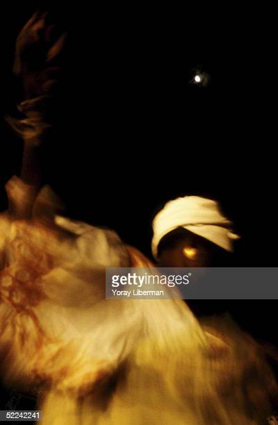 Woman dances a traditional dance to praise Allah April 22 2003 in Mbake Senegal The Mouride Baye Fall community in Senegal celebrates the Magal De...