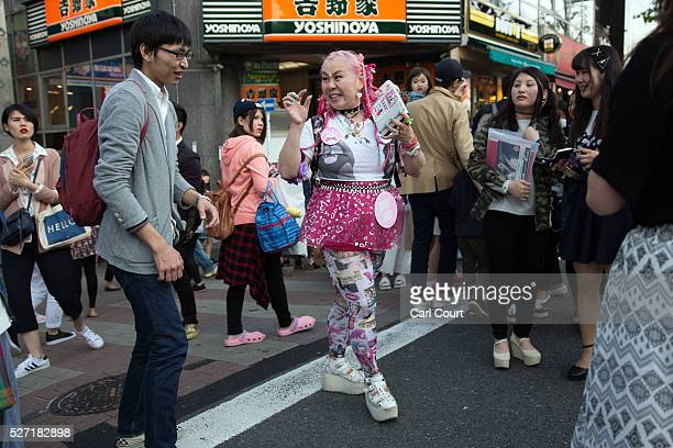 A woman dances and listens to music on April 30 2016 in the Harajuku area of Tokyo Japan The Greater Tokyo Area is the most populous metropolitan...