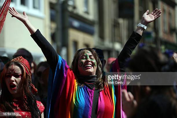 A woman dances as she takes part in a Beltane May Day celebration in Glastonbury main street on May 1 2013 in Glastonbury England Although more...