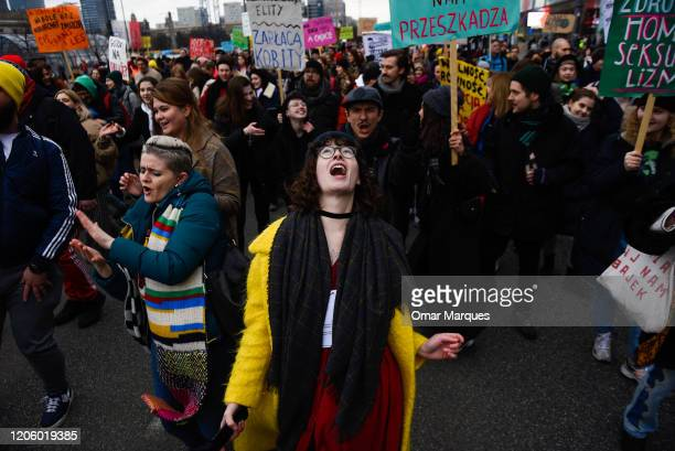 A woman dances as she takes part in the 'Feminism For Climate' International Women's Day March on March 8 2020 in Warsaw Poland This year the...