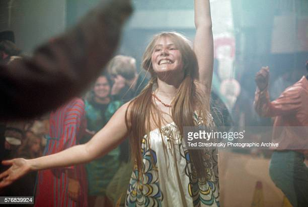 A woman dances at the Acid Test Graduation a celebration organized by Ken Kesey and his Merry Pranksters in which participants graduated beyond acid...