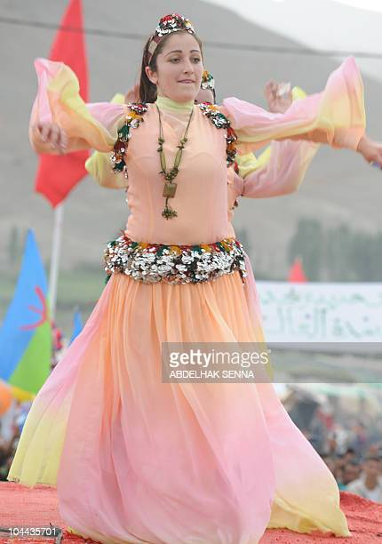 A woman dances during a berber group wedding ceremony in the high Atlas Mountain Berber village of Imilchil on September 23 2010 Once a year in...