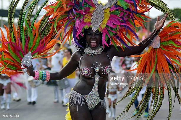 A woman dances during La Gran Parada de Fantasía as part of Carnaval de Barranquilla 2016 on February 08 2016 in Barranquilla Colombia
