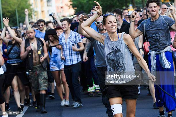 A woman dances during the 'Zug der Liebe' techno and electronic music parade on July 25 2015 in Berlin Germany The 'Zug der Liebe' is the successor...