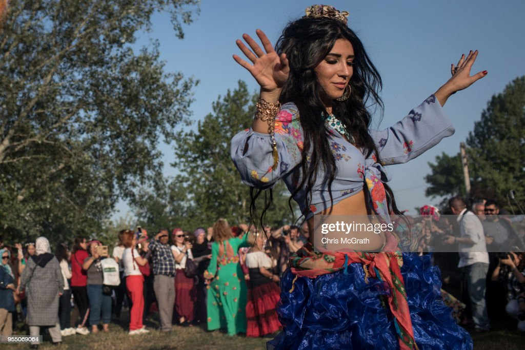 A woman dances in front of a large bonfire during the Kakava Festival on May 5, 2018 in Edirne, Turkey. The annual Kakava (Hõdõrellez) spring festival celebrates the coming of spring amongst the Roma community.