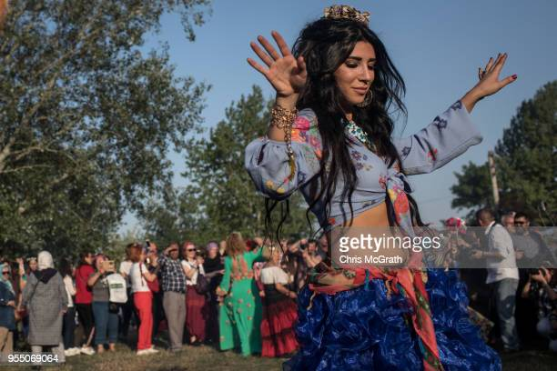 Woman dances in front of a large bonfire during the Kakava Festival on May 5, 2018 in Edirne, Turkey. The annual Kakava spring festival celebrates...