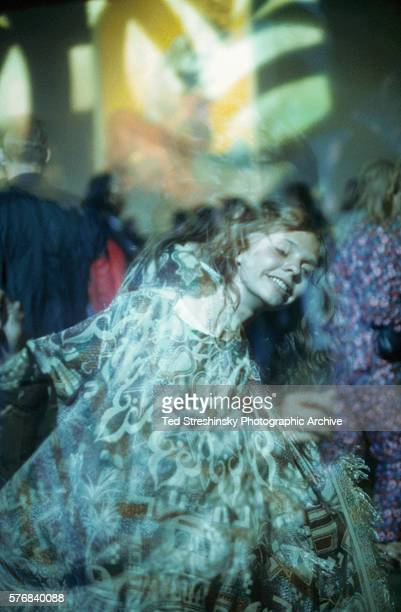 A woman dances in the glow of psychedelic light at Avalon Ballroom in San Francisco