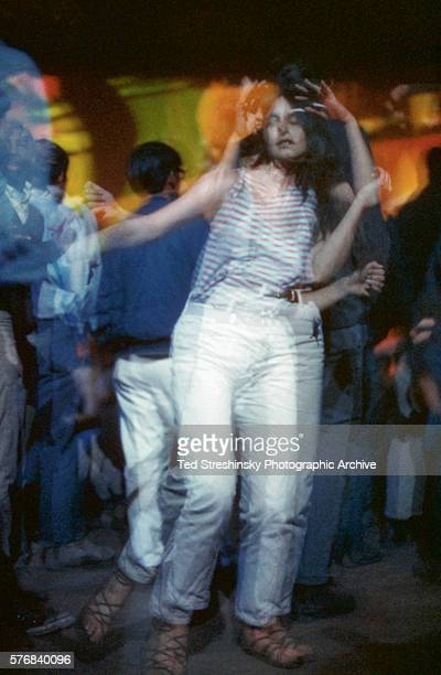 Woman dances in the glow of psychedelic light at Avalon Ballroom in San Francisco.