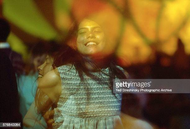 Woman dances in the glow of psychedelic light at the Avalon Ballroom in San Francisco.