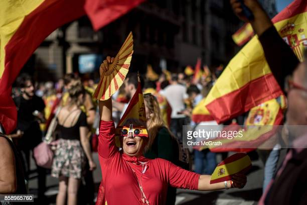A woman dances in the street during a protest against Catalonia's indepedence on October 8 2017 in Barcelona Spain Large numbers of citizens are...