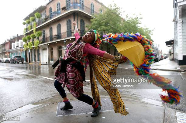 A woman dances in the street in the French Quarter before Hurricane Nate makes landfall on October 7 2017 in New Orleans Louisiana Nate is expected...