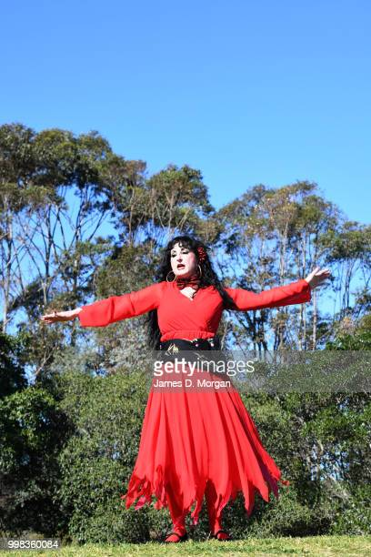A woman dances on a hilltop dressed as Kate Bush on July 14 2018 in Sydney Australia The Most Wuthering Heights Day is when people all around the...