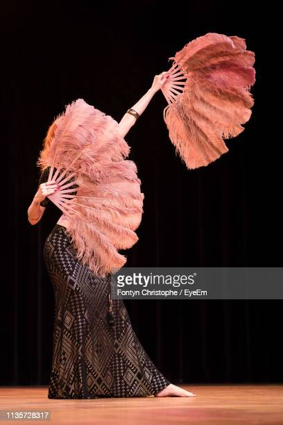 Woman Dancing Against Black Background