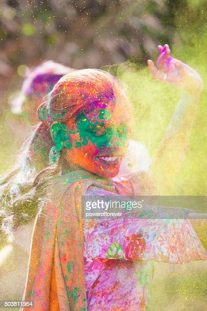 Woman dancing at Holi Festival in India
