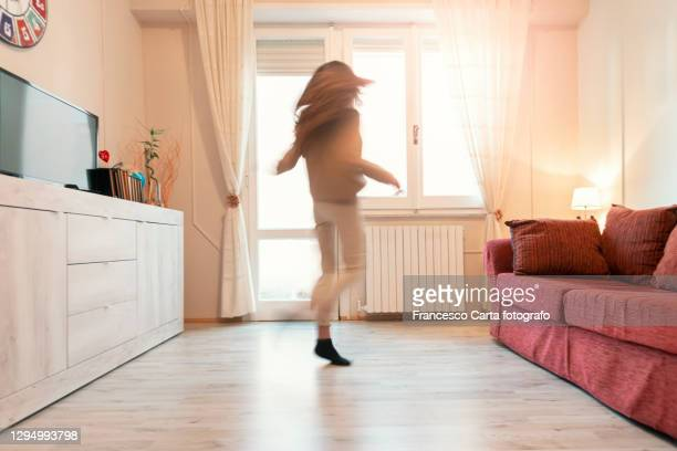 woman dancing at home - long exposure stock pictures, royalty-free photos & images