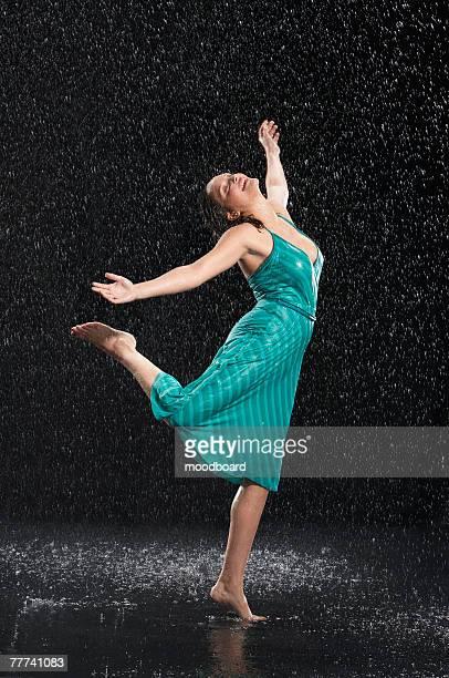 Woman Dancing Barefoot in the Rain