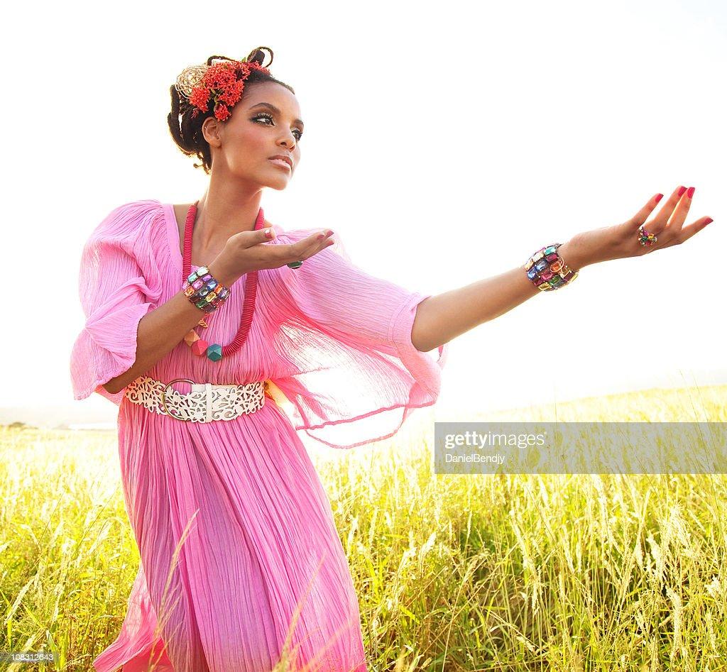 Woman Dancing In Field : Stock Photo