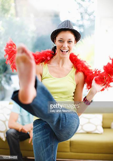 Woman dancing in hat and feather boa
