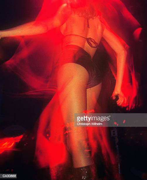 woman dancing in nightclub, low angle view (blurred motion) - clubkleding stockfoto's en -beelden
