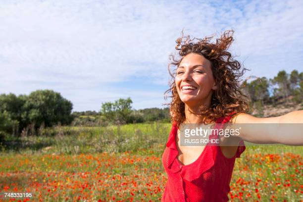 woman dancing in poppy field, palma de mallorca, islas baleares, spain, europe - palma majorca stock photos and pictures