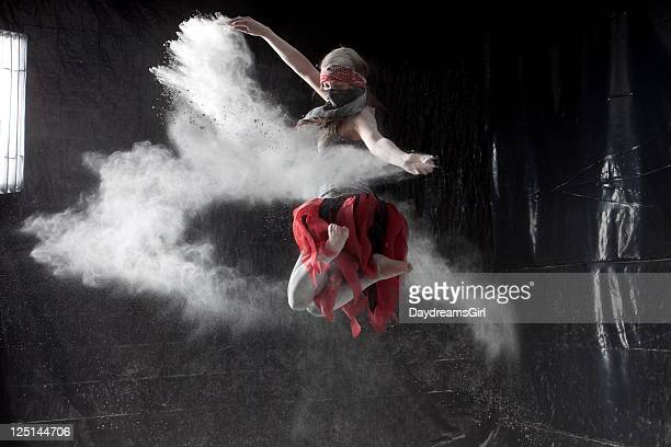 Woman Dancing in White Powder