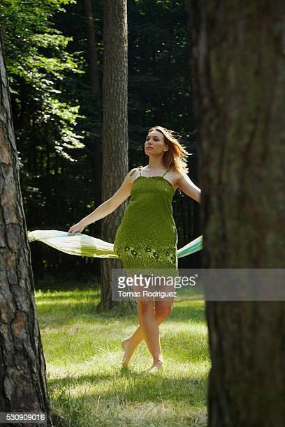 Woman Dancing in Woods