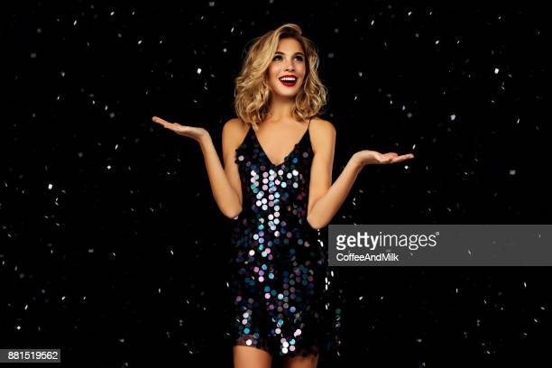 woman dancing on a party over black background with confetti - cocktail dress stock pictures, royalty-free photos & images