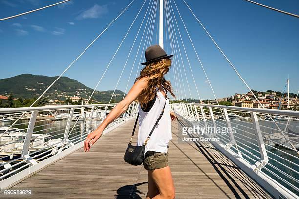 Woman dancing on a pedestrian bridge