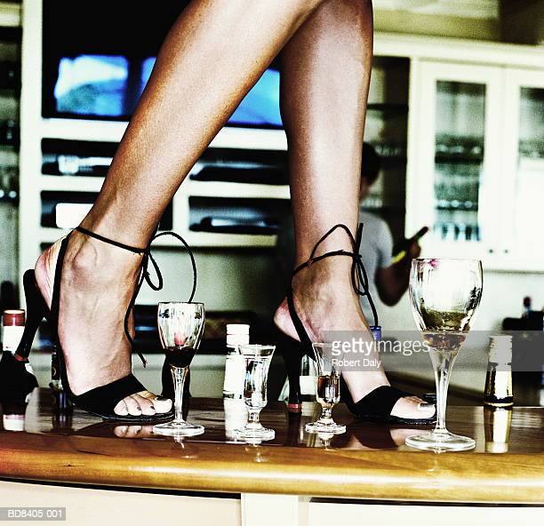 Woman dancing on bar, low section