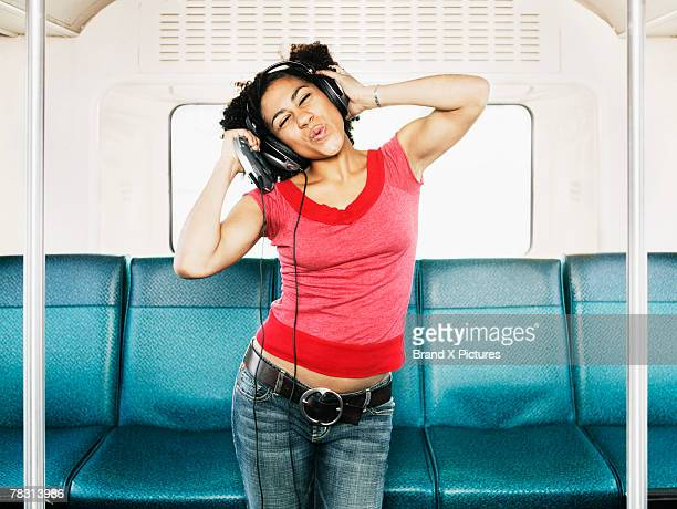woman dancing on bus - personal compact disc player stock pictures, royalty-free photos & images